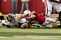 25 November 2011: Quarterback Taylor Martinez #3 of the Nebraska Cornhuskers recovers his fumble in the first quarter against the Iowa Hawkeyes at the Memorial Stadium in Lincoln, Nebraska. Nebraska defeated Iowa 20 to 7.