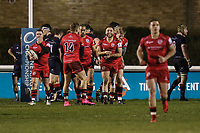 Mark Best of Jersey Reds (centre) celebrates after he scores a try during the Greene King IPA Championship match between London Scottish Football Club and Jersey Reds at Richmond Athletic Ground, Richmond, United Kingdom on 16 March 2018. Photo by David Horn.