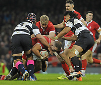 Wales Dillon Lewis is tackled by Barbarians Campese Maafu and Campese Maafu<br /> <br /> Photographer Ian Cook/CameraSport<br /> <br /> 2019 Autumn Internationals - Wales v Barbarians - Saturday 30th November 2019 - Principality Stadium - Cardifff<br /> <br /> World Copyright © 2019 CameraSport. All rights reserved. 43 Linden Ave. Countesthorpe. Leicester. England. LE8 5PG - Tel: +44 (0) 116 277 4147 - admin@camerasport.com - www.camerasport.com