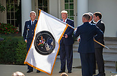 "The flag of the United States Space Command is displayed during the ceremony where United States President Donald J. Trump established the US Space Command in the Rose Garden of the White House in Washington, DC on Thursday, August 29, 2019.  The Space Command will be the lead military agency for the planning and execution of space operations and will be a step towards establishing a Space Force as a new military service.  At left is General John W. ""Jay"" Raymond, Commander, Air Force Space Command.<br /> Credit: Ron Sachs / Pool via CNP"