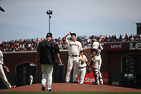 SAN FRANCISCO, CA - APRIL 24:  Matt Cain #18 of the San Francisco Giants stands on the mound with catcher Trevor Brown #14 waiting for manager Bruce Bochy #15 to remove him from the game against the Miami Marlins at AT&T Park on Sunday, April 24, 2016 in San Francisco, California. Photo by Brad Mangin