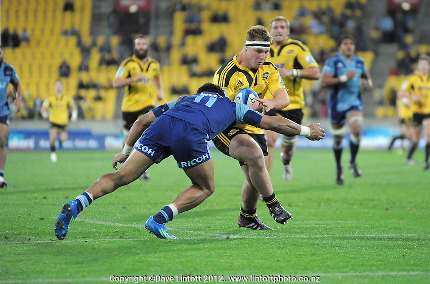 Hurricanes prop Reggie Goodes surges for the line during the Super 15 rugby match between the Hurricanes and Blues at Westpac Stadium, Wellington, New Zealand on Friday, 4 May 2012. Photo: Dave Lintott / lintottphoto.co.nz
