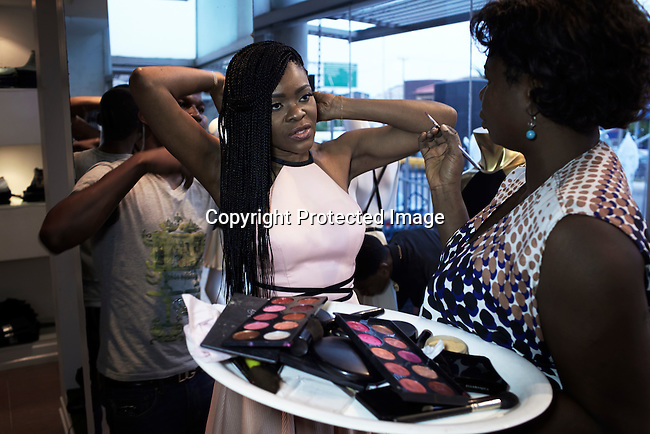 LAGOS, NIGERIA MAY 24: Nigerian fashion designer Deola Sagoe has her makeup done during a photo shoot in her flagship store on May 24, 2013 on Victoria Island in Lagos, Nigeria. Deola is one of the best and celebrated local designers and she has shown her designs around Africa and the world. (Photo by: Per-Anders Pettersson)