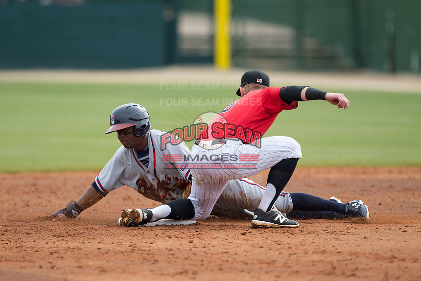 Anfernee Seymour (9) of the Rome Braves is tagged out by Kannapolis Intimidators shortstop Max Dutto (6) as he attempts to steal second base at Kannapolis Intimidators Stadium on April 12, 2017 in Kannapolis, North Carolina.  The Braves defeated the Intimidators 4-3.  (Brian Westerholt/Four Seam Images)