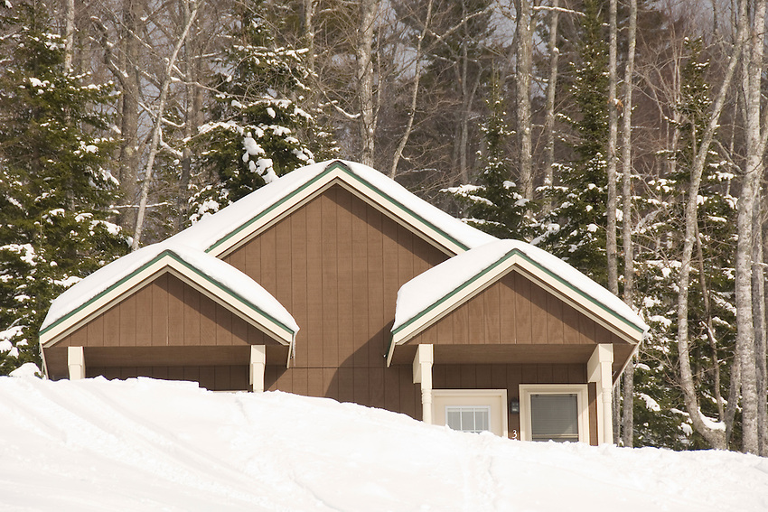 A large snowbank partially obscures a trailside lodging cabin at Mount Bohemia Ski Resort in Michigans Upper Peninsula.
