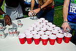 AJ Okereke, Joe Dilfore and Paul O'Connell of Santa Barbara, California prep for a game of 21 cup rapid beer pong in the camping area outside of the Coachella Valley Music and Arts Festival in Indio, California April 10, 2015. (Photo by Kendrick Brinson)