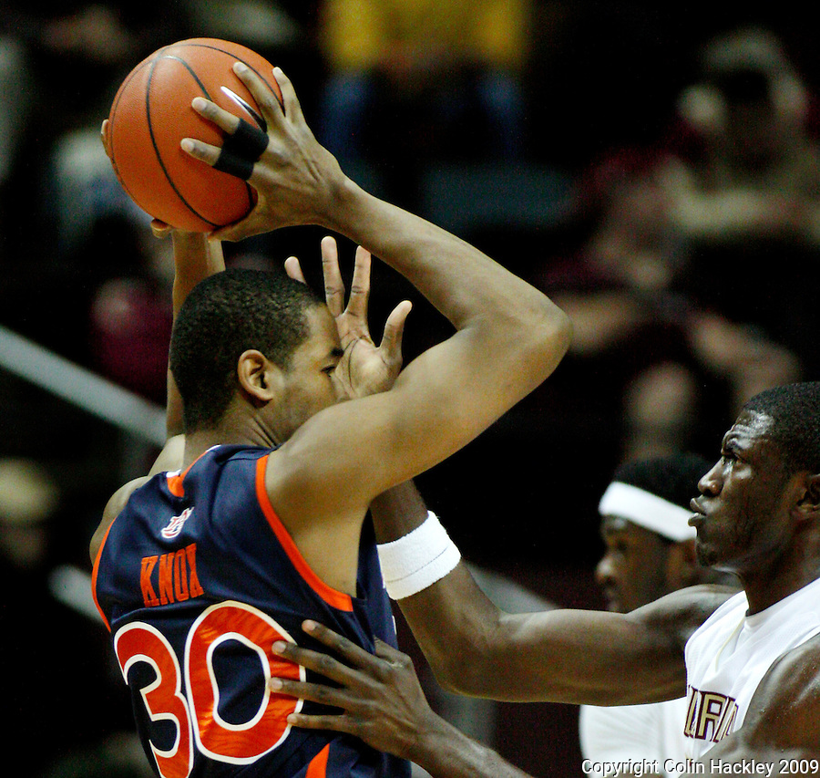 TALLAHASSEE, FL 12/11/09-FSU-AU BB09 CH11-Florida State's Solomon Alabi gets in the face of Auburn's Brendon Knox during first half action Thursday at the Donald L. Tucker Center in Tallahassee...COLIN HACKLEY PHOTO