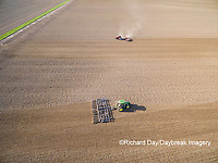 63801-10209 Farmer tilling field before planting corn-aerial Marion Co. IL