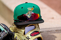A Clinton LumberKings hat sits on top of a glove on the dugout steps during a Midwest League game against the Wisconsin Timber Rattlers on April 26, 2018 at Fox Cities Stadium in Appleton, Wisconsin. Clinton defeated Wisconsin 7-3. (Brad Krause/Four Seam Images)