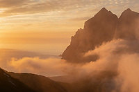 Summer fog conceals Bunes beach at sunset, Moskenesøy, Lofoten Islands, Norway