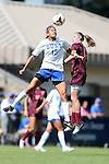 29 September 2013: Duke's Kim DeCesare (19) and Virginia Tech's Ashley Meier (right) challenge for a header. The Duke University Blue Devils hosted the Virginia Tech University Hokies at Koskinen Stadium in Durham, NC in a 2013 NCAA Division I Women's Soccer match. The game ended in a 1-1 tie after two overtimes.