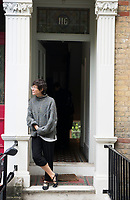 Annuska at the door of 116 Erlanger Road waiting for Felix to leave for his first day of school. London, England, Great Britain
