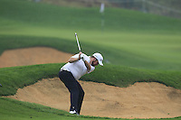 Shane Lowry (IRL) plays his 2nd shot on the 2nd hole during Thursday's Round 1 of the 2014 BMW Masters held at Lake Malaren, Shanghai, China 30th October 2014.<br /> Picture: Eoin Clarke www.golffile.ie
