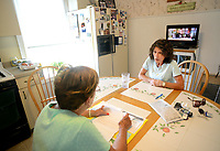 EDITORS NOTE: DIBRINO WAS CONCERNED ABOUT SHOWING HER FACE IN THE IMAGES: Donna Cliggett (right) helps her mother Carmella DiBrino, as they look through paperwork after a scammer bilked her of $11,000 in gift cards Tuesday, September 05, 2017 in Hatboro, Pennsylvania. Someone pretending to be her grandson called her on the phone and said they needed money to get out of jail and pay a lawyer. She then purchased 11,000 in gift cards at Walmart and read numbers off the back of the cards to the scammer, who hasn't been caught. She is fighting Walmart and her bank to get the money back. (WILLIAM THOMAS CAIN / For The Philadelphia Inquirer)