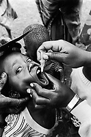 Burundi. Karuzi Province. Bugenyuzi. Polio vaccination campaign. A young boy receives his vaccination treatment. © 2000 Didier Ruef