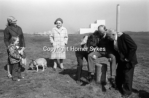 Dunting the Freeholder, Newbiggin by the Sea. Northumberland  1974. Vandalized Moot Stone now use a small concrete pillar. A new freeholder is dunted.<br />