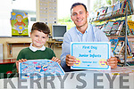 All on my own Jason O'Malley who started school in Coars NS on Thursday pictured here with his teacher Paul O'Connor.