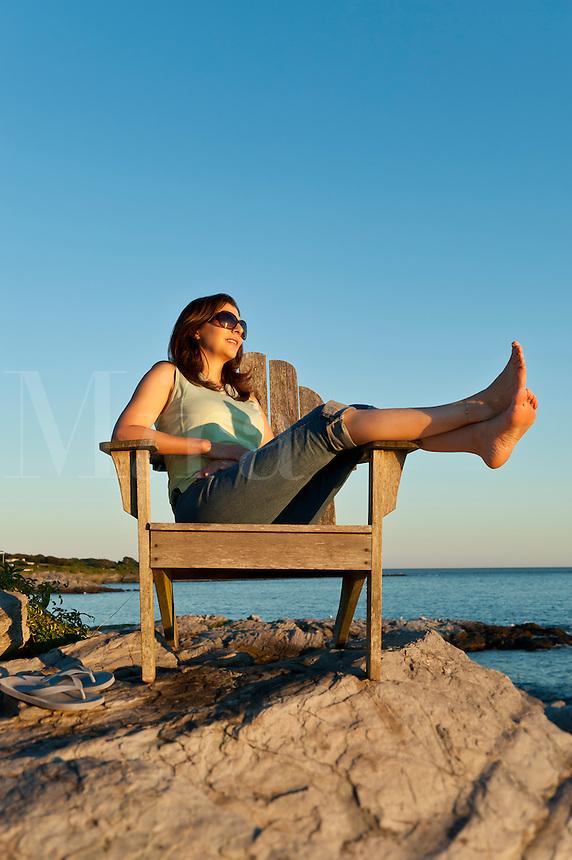 Woman enjoys the coastal view, Newport, Rhode Island.