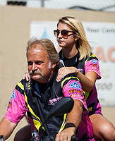Jul 23, 2017; Morrison, CO, USA; NHRA pro stock motorcycle rider James Surber (left) and daughter Melissa Surber during the Mile High Nationals at Bandimere Speedway. Mandatory Credit: Mark J. Rebilas-USA TODAY Sports