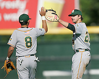 Baylor 1B Adam Hornung (20) celebrates with Baylor 3B Shaver Hansen (8) a rare victory over Texas on May 3rd, 2008. Photo by Andrew Woolley / Four Seam Images