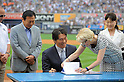 Hideki Matsui,<br /> JULY 28, 2013 - MLB :<br /> Hideki Matsui signs his reitement papers with Yankees assistant general manager Jean Afterman as his father Masao and mother Saeko look on during his official retirement ceremony before the Major League Baseball game against the Tampa Bay Rays at Yankee Stadium in The Bronx, New York, United States. (Photo by AFLO)