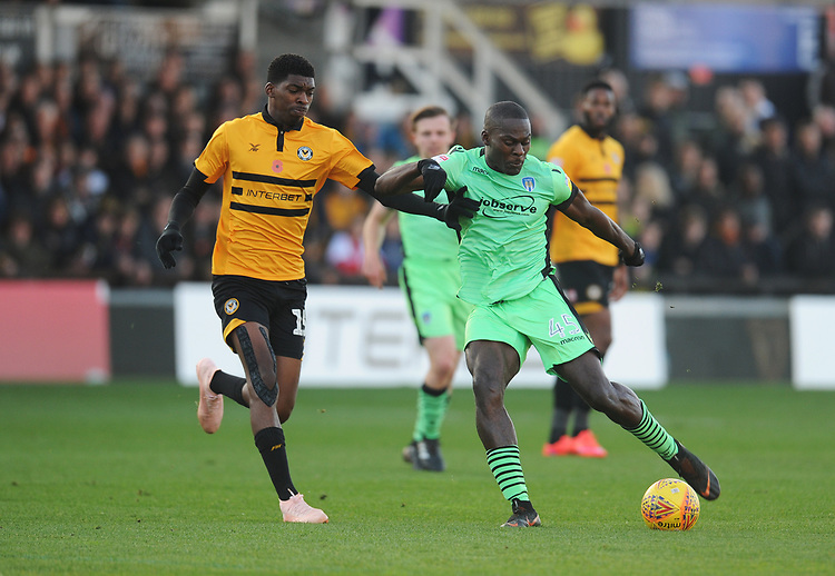 Colchester United's Frank Nouble under pressure from Newport County's Tyreeq Bakinson<br /> <br /> Photographer Kevin Barnes/CameraSport<br /> <br /> The EFL Sky Bet League Two - Newport County v Colchester United - Saturday 17th November 2018 - Rodney Parade - Newport<br /> <br /> World Copyright © 2018 CameraSport. All rights reserved. 43 Linden Ave. Countesthorpe. Leicester. England. LE8 5PG - Tel: +44 (0) 116 277 4147 - admin@camerasport.com - www.camerasport.com