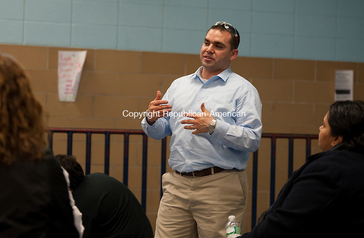 WATERBURY,  CT-121714JS14- Kennedy High School Robotics Team coach, Vincent Balsamo, talks with parents during an open house in which the student demonstrated their skills.<br /> Jim Shannon Republican-American