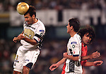 UNAM Pumas defender Joaquin Beltran (L) heads the ball as his teammate Fernando Morales (C) and Brazilian International's forward Fernandao look on during their qualifiying game for the Copa Libertadores at the University Stadium, March 8, 2006. International won 2-1 to UNAM Pumas. Photo by Javier Rodriguez