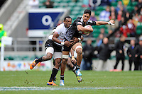 Akira Ioane of New Zealand is tackled by Osea Kolinisau of Fiji during Day Two of the iRB Marriott London Sevens at Twickenham on Sunday 11th May 2014 (Photo by Rob Munro)