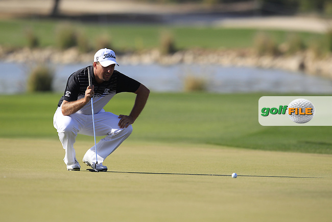 Darren FICHARDT (RSA) lines up his putt on the 15th green during Saturday's Final Round of the 2015 Commercial Bank Qatar Masters held at Doha Golf Club, Doha, Qatar.: Picture Eoin Clarke, www.golffile.ie: 1/24/2015