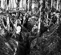 BNPS.co.uk (01202 558833)<br /> NARA/BNPS<br /> <br /> British infantrymen in trenches along the Maas River' west bank in late November. <br /> <br /> Remarkable rarely seen photos of heroic Allied soldiers fighting their way across Europe before crossing the River Rhine 75 years ago feature in a new book.<br /> <br /> They are published in Images of War, Montgomery's Rhine Crossing, which tells the story of the legendary offensive, nicknamed Operation Plunder, in March 1945.<br /> <br /> On the night of March 23, Field Marshal Bernard Montgomery's 21st Army Group launched a massive artillery, amphibious and airborne assault to breach the historic defensive water barrier protecting northern Germany.<br /> <br /> At the same time, the Americans, with the support of the British 6th Airborne Division, set in motion Operation Varsity - involving 16,000 paratroopers - on the east bank of the Rhine. They were dropped here to seize bridges to prevent German reinforcements from contesting the bridgeheads.<br /> <br /> Fierce fighting ensued, with much bloodshed on both sides as the Allies met determined resistance from machine gun nests. But the daring operation proved successful, helping to considerably shorten the war - the Nazis surrendered just six weeks later.
