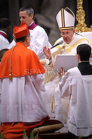 Italian cardinal Beniamino Stella r receives his beret as he is being appointed cardinal by Pope Francis  at the consistory in the St. Peter's Basilica at the Vatican on February 22, 2014.