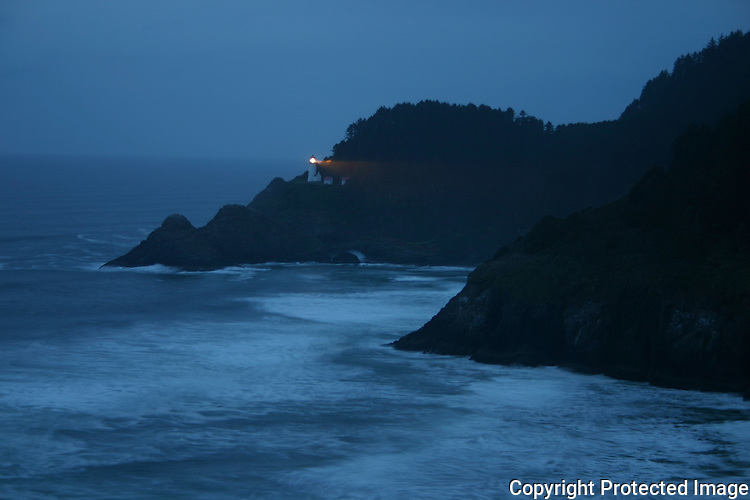 Casting its light from coast to sea, the Haceta Head Lighthouse warns mariners of the hazards of the rocky coast north of Florence, Oregon.