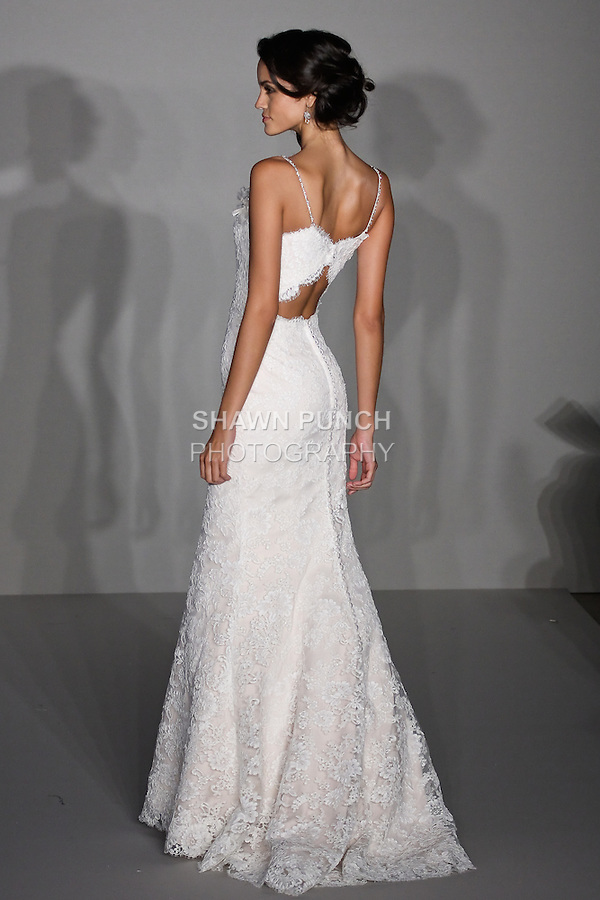 Model walks runway in an ivory/Champagne soft fluted Alencon lace gown, sweetheart neckline with beaded spaghetti straps and jeweled floral corsage, open back wedding dress by Jessica Williams, for the Alvina Valenta Spring 2012 Bridal collection, at the JLM Couture fashion show, during Bridal Week New York Spring 2012.