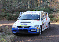 Mike Faulkner - Pete Foy in a Mitsubishi Lancer Evolution 9 competing at Junction 6 on the Munro Scotch Beef Millbuie Special Stage 1 on the 2014 Arnold Clark/Thistle Hotel Snowman Rally, supported by Highland Office Equipment, part of Capital Document Solutions which was organised by Highland Car Club and based in Inverness on 22.2.14; Round 1 of the 2014 RAC MSA Scottish Rally Championship sponsored by ARR Craib Transport Limited.