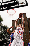 Kyle Singler (33) goes up for a dunk in front of Jerryd Bayless (5) during the Elite 24 Hoops Classic game on September 1, 2006 held at Rucker Park in New York, New York.  The game brought together the top 24 high school basketball players in the country regardless of class or sneaker affiliation.