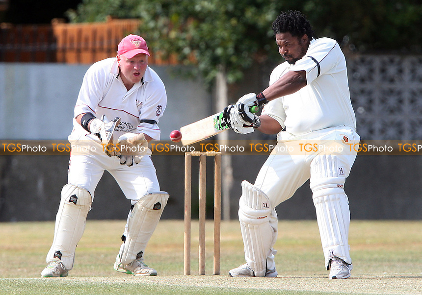 Robert Rollins of Wickford in batting action with Hornchurch wicket keeper Paul Murray in close attendance - Wickford Cricket Club vs Hornchurch Cricket Club at Wickford - 05/09/09 - MANDATORY CREDIT: Rob Newell/TGSPHOTO - Self billing applies where appropriate - 0845 094 6026 - contact@tgsphoto.co.uk - NO UNPAID USE.