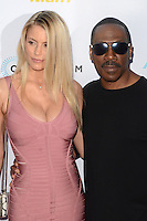 HOLLYWOOD, CA - JULY 25: Paige Butcher and Eddie Murphy at the Premiere Of Cinedigm's 'Amateur Night' at ArcLight Hollywood on July 25, 2016 in Hollywood, California. Credit: David Edwards/MediaPunch