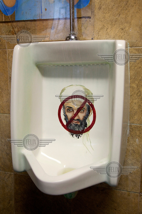 A picture of Osama Bin Laden painted on a men's urinal in a bar in Florida..