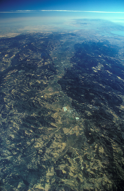 Aerial from 30,000 feet with Calistoga in center foreground. San Francisco Bay in distance