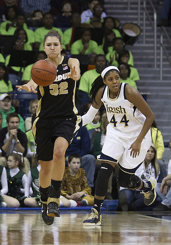 December 29, 2012:  Purdue forward Sam Ostarello (32) passes the ball as Notre Dame forward Ariel Braker (44) defends during NCAA Women's Basketball game action between the Notre Dame Fighting Irish and the Purdue Boilermakers at Purcell Pavilion at the Joyce Center in South Bend, Indiana.  Notre Dame defeated Purdue 74-47.