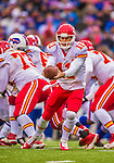 9 November 2014: Kansas City Chiefs quarterback Alex Smith makes a second quarter hand-off against the Buffalo Bills at Ralph Wilson Stadium in Orchard Park, NY. The Chiefs rallied with two fourth quarter touchdowns to defeat the Bills 17-13. Mandatory Credit: Ed Wolfstein Photo *** RAW (NEF) Image File Available ***