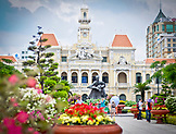VIETNAM, Ho Chi Minh, Saigon, Tet Holiday, City Hall, Hôtel de Ville de Saïgon, tourists and people visiting and taking pictures next to the statue of Uncle Ho sitting next to a girl