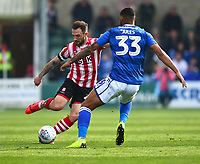 Lincoln City's Neal Eardley vies for possession with Macclesfield Town's Zak Jules<br /> <br /> Photographer Andrew Vaughan/CameraSport<br /> <br /> The EFL Sky Bet League Two - Lincoln City v Macclesfield Town - Saturday 30th March 2019 - Sincil Bank - Lincoln<br /> <br /> World Copyright © 2019 CameraSport. All rights reserved. 43 Linden Ave. Countesthorpe. Leicester. England. LE8 5PG - Tel: +44 (0) 116 277 4147 - admin@camerasport.com - www.camerasport.com