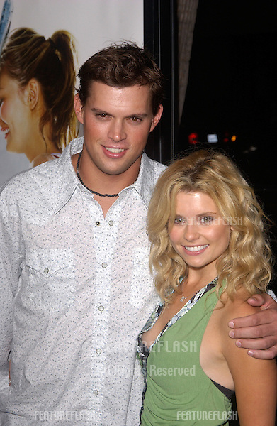 Actress JOANNA GARCIA & boyfriend tennis star BOB BRYAN at the world premiere, in Beverly Hills, of the new tennis romantic comedy Wimbledon..September 13, 2004