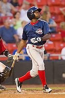 Center fielder Jackie Bradley #10 of the Greenville Drive follows through on his swing against the Hickory Crawdads at L.P. Frans Stadium on September 3, 2011 in Hickory, North Carolina.  The Crawdads defeated the Drive 3-0.  (Brian Westerholt / Four Seam Images)