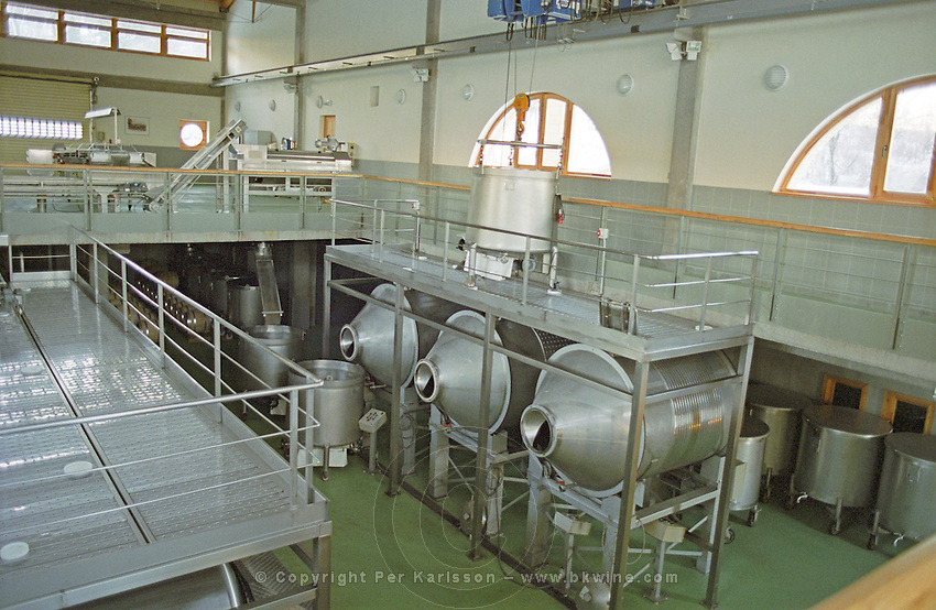 Inside the Oremus winery in Tolcsva, Tokaj - very modern wine making equipment. The three round containers are rotating fermentation tanks. Oremus is owned by the Alvarez family that also owns Vega Sicilia in Spain It is managed by Andras Bacso. Credit Per Karlsson BKWine.com