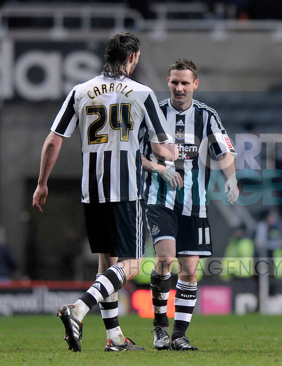 Newcastle's Andy Carroll and Peter Lovenkrands celebrate at the final whistle.