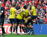 Callum O'Dowda (15) of Oxford United celebrates with his team mates after scoring the opening goal with a header past goalkeeper Adam Davies of Barnsley during the Johnstone's Paint Trophy Final match between Oxford United and Barnsley at Wembley Stadium, London, England on 3 April 2016. Photo by Alan  Stanford / PRiME Media Images.
