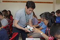 OrigamiUSA 2016 Convention at St. John's University, Queens, New York, USA. Jason Ku helps folders in Kade Chan's Capricorn class.